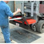 Waste is easily released from forklift magnetic sweeper by operating lever